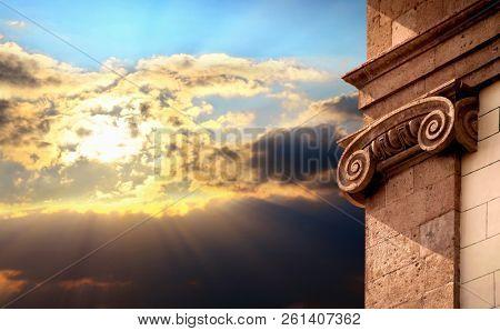 Close up column detail over sunset sky