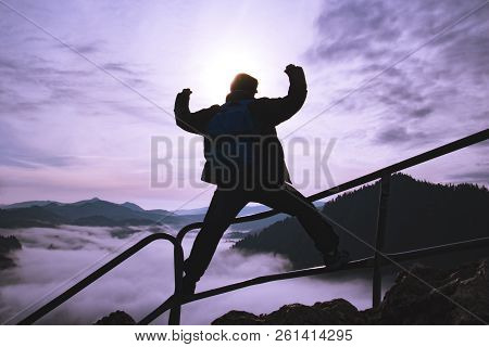 Man With Raised Arms On Top Of A Surreal Mountain, Concept Of Inspiration, Enthusiasm And Aspiration