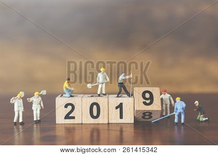 Miniature Worker Team Building Wooden Block Number 2019 On Wooden Background