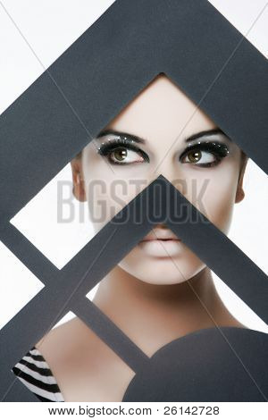 studio portrait of young beautiful woman with bright eye make up