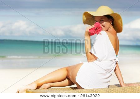 young attractive woman relaxing on beach