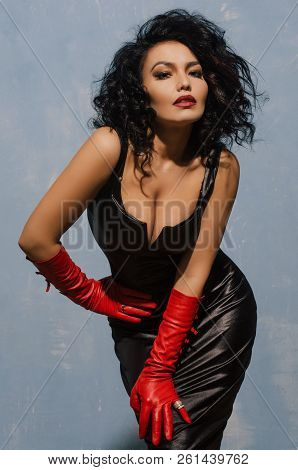 Beautiful Fetish Model Wearing Black Spandex Dress And Long Red Leather Gloves.