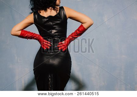 Beautiful Fetish Model Wearing Black Spandex Dress And Long Red Leather Gloves Back.