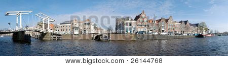 A 180 degrees panoramic view over a river, with the old city center of Dutch town, it's old houses, the Museum, and the classic draw bridge across the canal. This stitch has been made out of 34 images