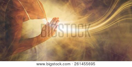 Peaceful Prayer Sending Love And Light Out -  Female In White Dress With Hands In Prayer Position An