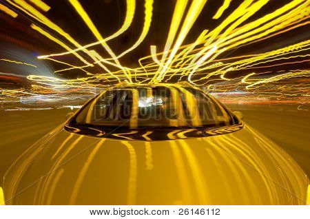 A car driving through the frantic traffic of a busy city during rush hour (Quadruple exposure)