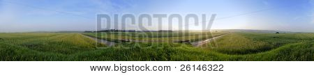 A 360 degree panoramic image of wheat fields in the Belgian Ardennes during sunset on a nice summer evening.