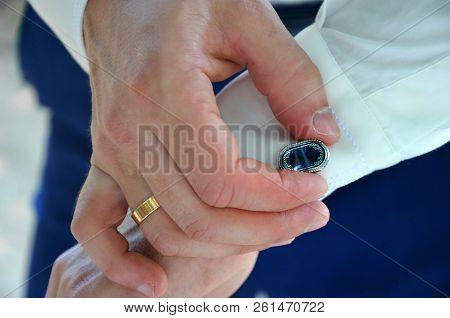 The Groom Straightens Cufflinks On His Shirt. Fees Groom, Wedding And Honeymoon In The Tropics On Th