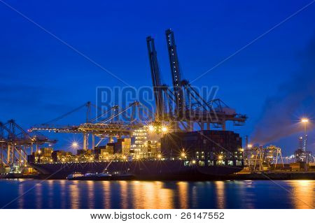 The activity of loading and unloading of huge container ships at the world's biggest and busiest container harbor in Rotterdam