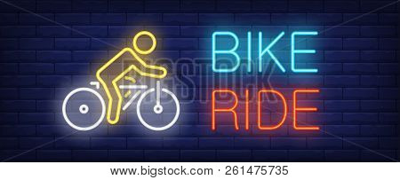 Bike Ride Neon Text With Cyclist Riding Bicycle. Bicycling, Sport And Advertisement Design. Night Br