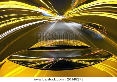 A car driving on a mortorway at high speeds