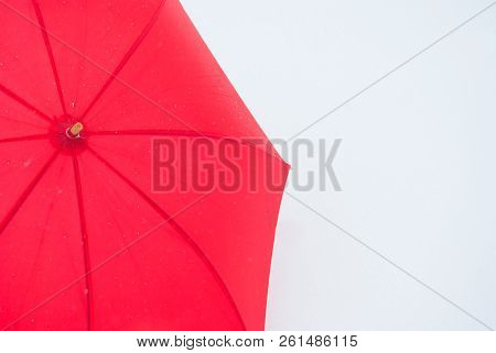 One Red Umbrella In Contrast With The White Snowy Ground