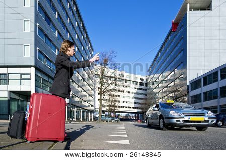 A businessman with several suitcases flagging a taxi poster