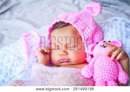 Cute Adorable Sweet Newborn Infant Girl In A Pink Funny Cap With Ears Sleeping. Strong And Serene Ne