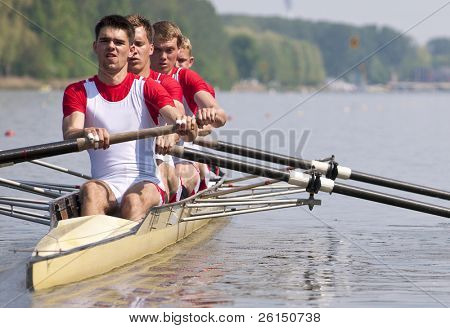 Coxed four rowing team during the first strokes after the start of a race poster