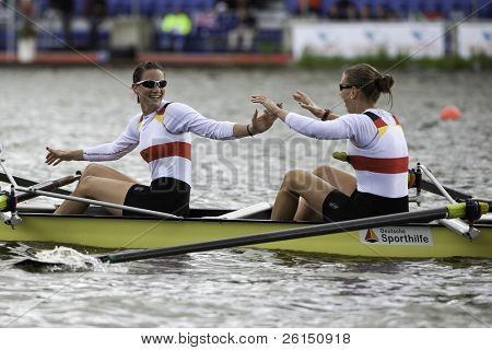 AMSTERDAM-JULY 23: Kuehne and Reimund (Germany Women's Four) smile as they become world champion under 23 in a world record time of 6:34.61. On July 23, 2011 in Bosbaan, Amsterdam, The Netherlands