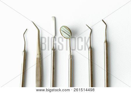 Professional Dentist Tools In Dental Office: Dentist Mirror, Forceps Curved, Explorer Curved, Dental