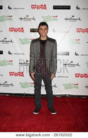 LOS ANGELES - NOV 27:  Adam Irigoyen arrives at the 2011 Hollywood Christmas Parade at Hollywood Boulevard at Sycamore on November 27, 2011 in Los Angeles, CA