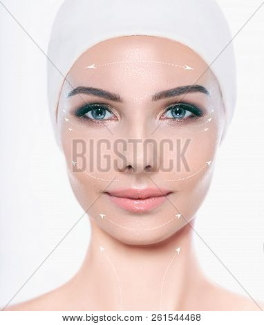 Beautiful Female Face With Lifting Arrows On Face , Facial Surgery And Lifting Effect