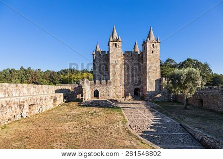 Santa Maria da Feira, Portugal - October 12, 2017: Entrance, Bailey and Keep of Castelo da Feira Castle. Walls with wallwalk, battlements and crenels