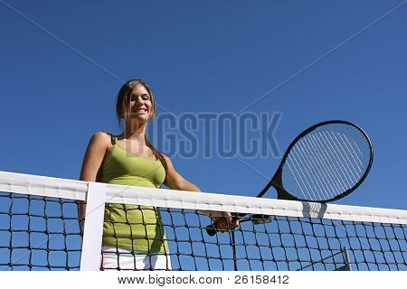 Happy Brunette woman with her tennis racquet