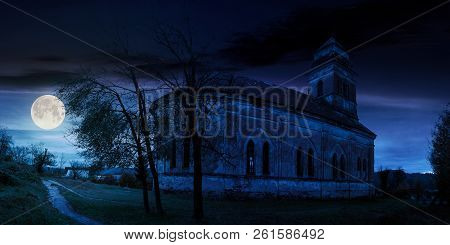 Panorama Of Abandoned Catholic Church On Hill At Night In Full Moon Light