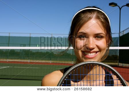 Smiling Female Tennis player with room for copy poster