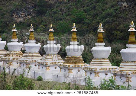 Small Chortens Or Memorials. Located Somewhere Near Lobesa. Punakha District. Bhutan