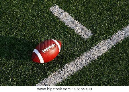 Collegiate football near the yard line