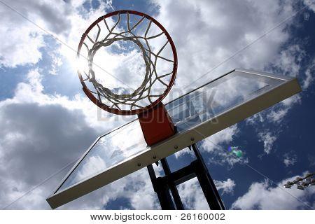 Basketball hoop with sun streak