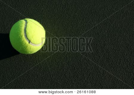 Tennis Ball on the Court with Room for Copy