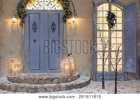 House Decorated For Christmas Outside. Vintage Courtyard Interior With Stairs, Porch, Door And Light