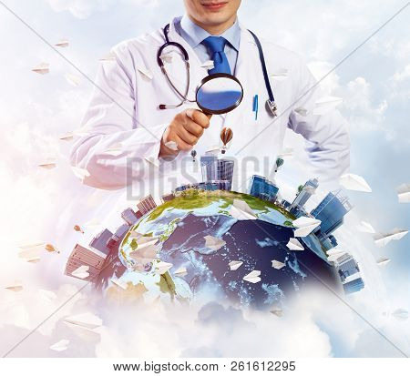 Young But Professional Man Doctor In White Sterile Suit And Stethoscope On His Neck Discovering Eart