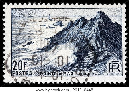 Luga, Russia - September 12, 2018: A Stamp Printed By France Shows View Of The Pointe Du Raz - A Pro