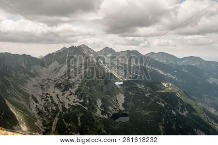 Many Peaks Of Western Tatras Mountains With Thrre Lakes Bellow From Volovec Mountain Peak On Slovaki