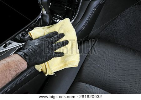 A man cleaning car with microfiber cloth. Car detailing. Valeting concept. Selective focus. Car detailing. Cleaning with sponge. Worker cleaning. Microfiber and cleaning solution to clean poster