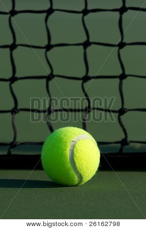 Tennis Ball against the Net with room for Copy