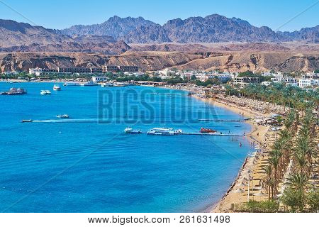 The Cozy Sand Beach Of Sharm El Maya Is Lined With Shady Palm Trees And Surrounded By Sinai Desert R