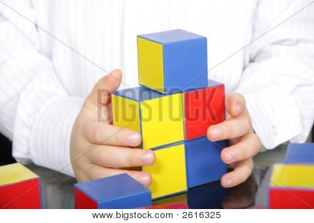 Hands And Color Bricks