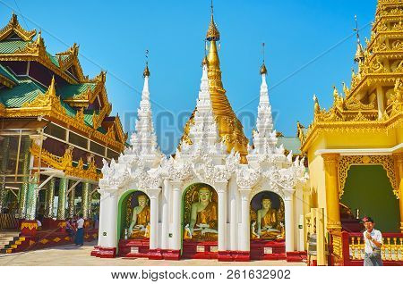 Yangon, Myanmar - February 27, 2018:  The Stunning Shrine With Images Of Buddha Touching Earth, Deco
