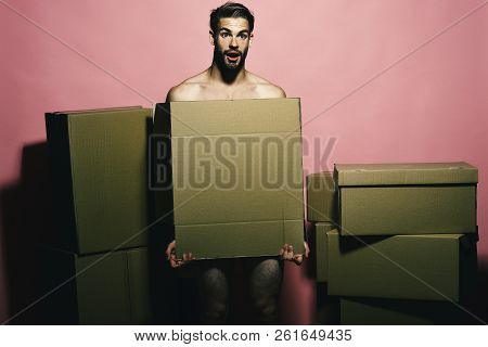 Sexuality And Moving Concept. Loader With Shocked Face Covers Nudity