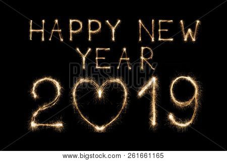 happy 2019 new year written with sparkler fireworks on black background with heart shape love