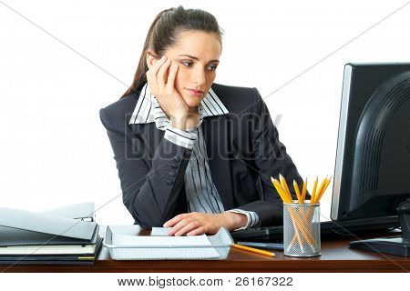 bored female office worker sits at her desk and look at computer screen, isolated on white background