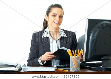 attractive female office worker checks something in her documents, folder, isolated on white background