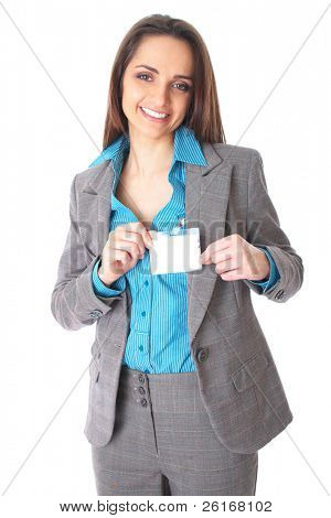attractive female holds blank name badge, wears blue shirt and suit, isolated on white background