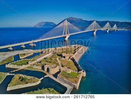 Fortress And Bridge Of Rio Antirio, Patra, Greece. Aerial Drone Bird's Eye View Photo.