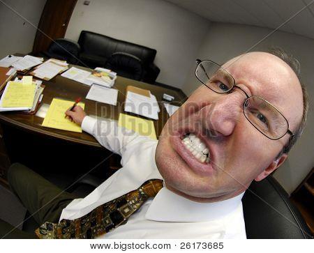 Mean looking man in business office gritting teeth