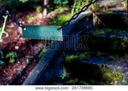 No Access Sign On Moss Covered Concrete Stairs With Shadows