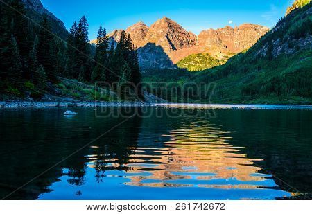 Golden Hour Sunrise Perfect View Of Infamous Maroon Bells Wilderness Reflections Off Rippling Waters