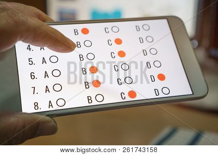 E-learning Exam Or Online Learning For Student In Smartphone By Finger Clicking Multichoice Form Onl